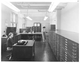 ISGS map room, 1955, left to right is Marilyn Thies, Margret Brophy and Genevieve Van Heyengen