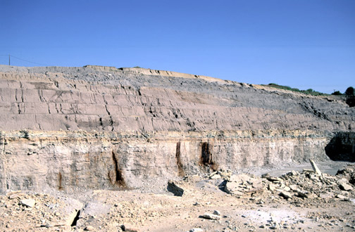 This photo of the Fox River Stone Company quarry near St. Charles, Illinois, shows approximately 100 feet of glacial drift over bedrock.