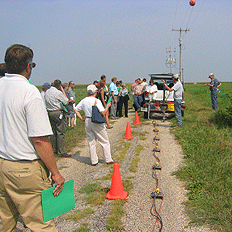 Attendees watch a seismic demonstration.