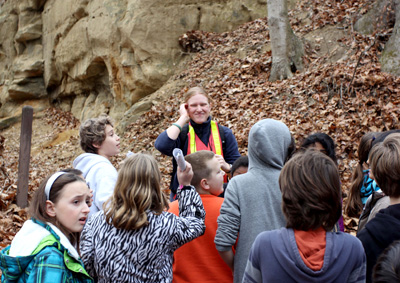 Geologist with students at outcropping