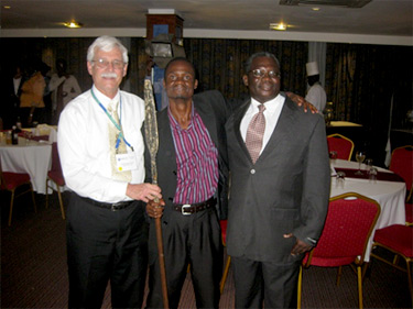 Left to right: Stohr, holding a ceremonial spear; Busta Chiona, Zomba Sister Cities Sino-African Initiative project manager; and Dickson Vuwa Phiri, chair of the Zomba Sister Cities Committee and head librarian for the University of Malawi.
