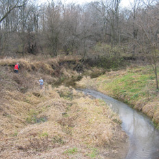 Scientists assessing impacts to an Illinois stream.