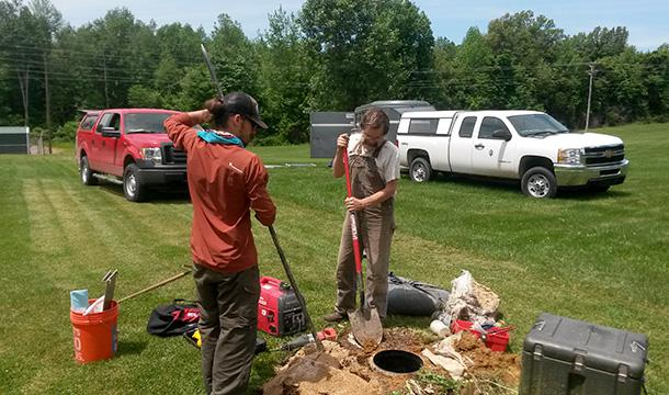 University of Illinois graduate student Mike DeLucia (left) and Indiana University professor Gary Pavlis (right) prepare to remove a seismometer vault in western Kentucky.