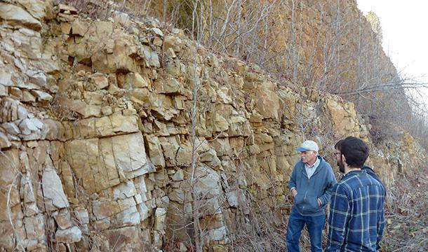 Scientists examine rock formation