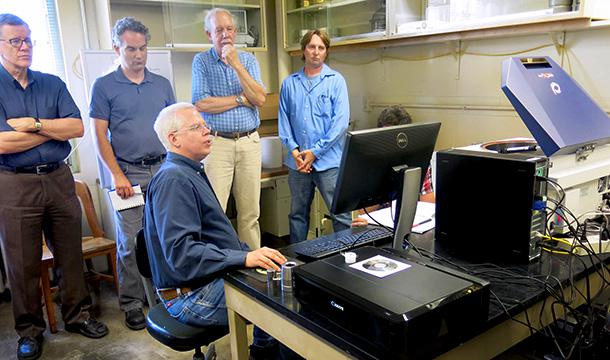 Installation demonstration. Front: Scott Fess of Rigaku. Back (left to right): Donald McKay, former director, Illinois State Geological Survey; Andrew Stumpf, Illinois State Geological Survey; Mick Machesky, Illinois State Water Survey; John Scott, Illinois Sustainable Technology Center.